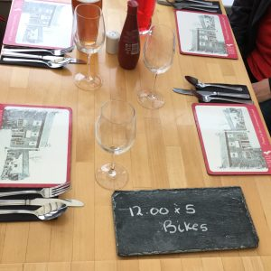 "Table placement with reserved sign reading ""12:00 x 5 Bikes"""